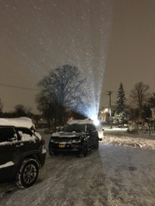 Exterior Lights projected onto building in snow, call now to reserve your date Event Planner NY EventPlannerNY.com (800) 736-8888