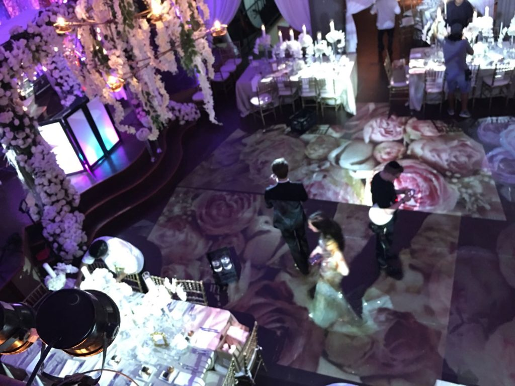 Floor Flowers projection, yes It's us! Call us to reserve your event date. Event Planner NY, EventPlannerNY.com (800) 736-8888